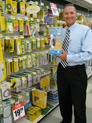 George Davison with product invention Petite Press in the store