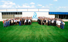 A photo of Davison employees standing behind Mr. Davison, CEO and Founder. Photo Credit: Davison
