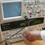 Designer using a oscilloscope