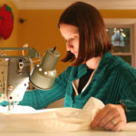 Designer sewing a invention prototype