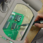 Designer soldering a circuit for a product invention prototype